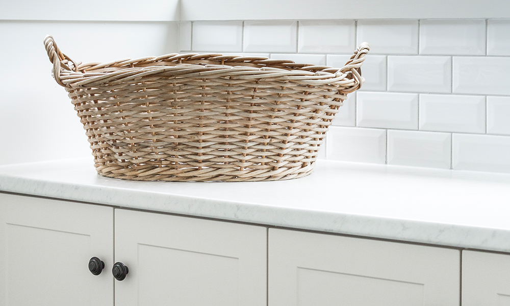 laundry renovations melbourne with a basket in view