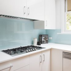 Teal glass splash back kitchen