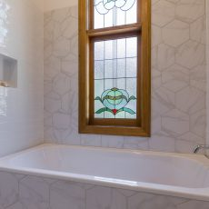 Hexagon tile feature wall in bathroom