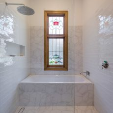 Wet room shower and bath space by MJ Harris Group