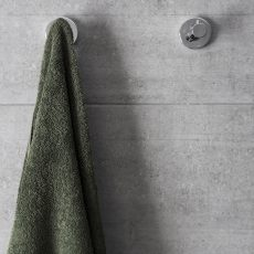 Grey towel and grey tiles in bathroom from a renovation in Thornbury