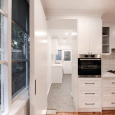 Hidden Laundry in Kitchen by MJ Harris Group