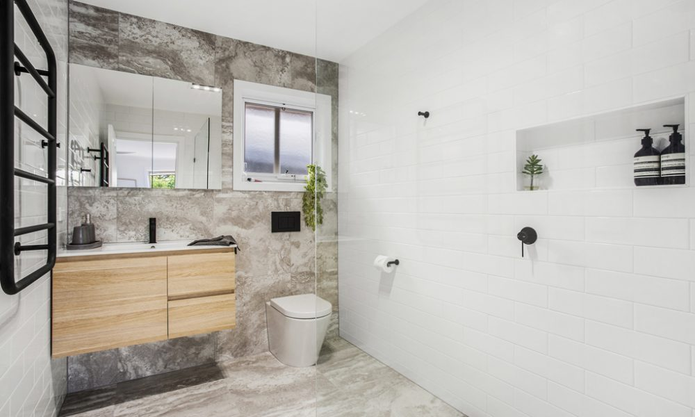 Walk in shower with niche in Vermont Bathroom