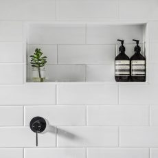 Showr Niche with subway tiles and white grout