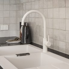 White sink and white tap ware