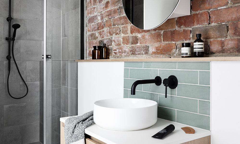 Bathroom with exposed brick feature wall by M.J. Harris Group in Brunswick, Melbourne
