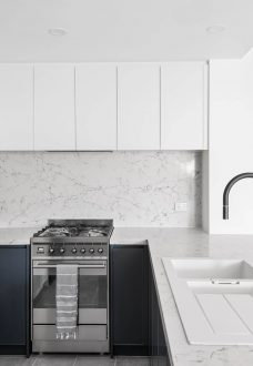 Southbank Apartment Kitchen Design Caesarstone White Attica Dulux Ticking M.J. Harris Group Melbourne