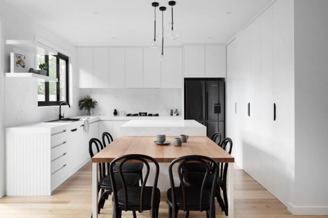 Mono chrome kitchen with timber table in Ivanhoe, Melbourne
